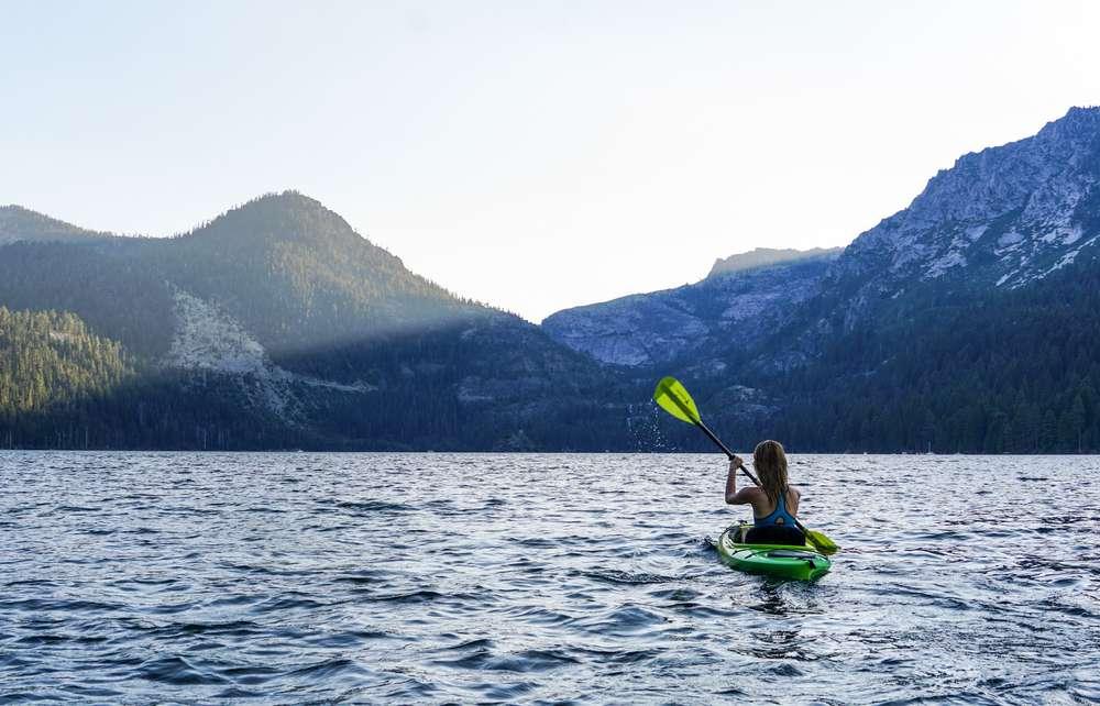 Photo of woman kayaking Lake Tahoe