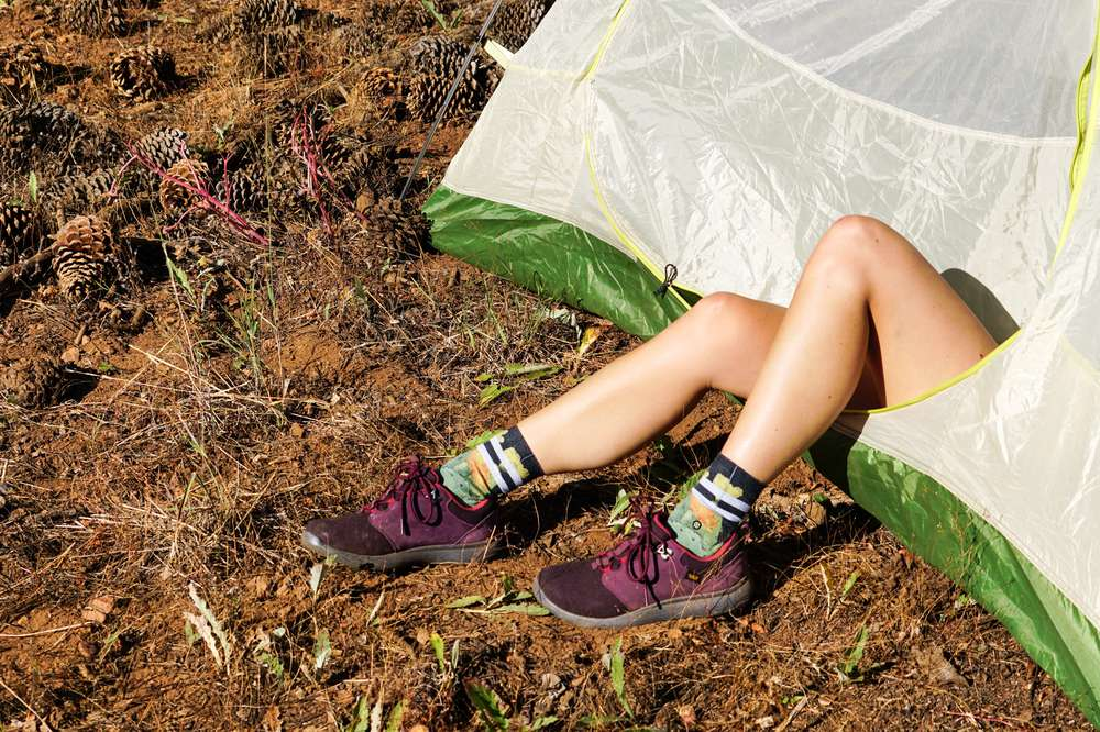 Photo of women's feet in a tent.