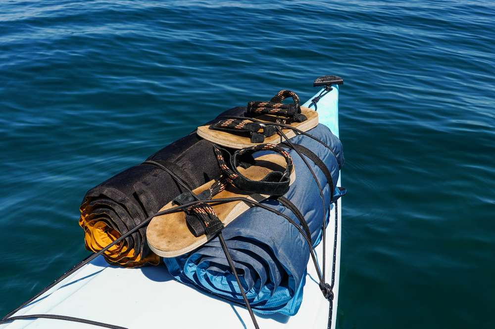 Photo of Teva Rope sandals strapped onto kayak