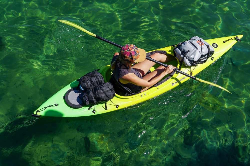 Photo of women sitting in kayak