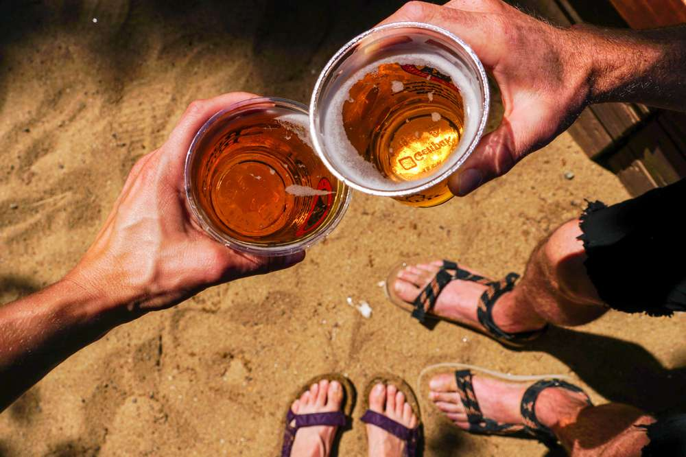 Photo of couple holding beer.
