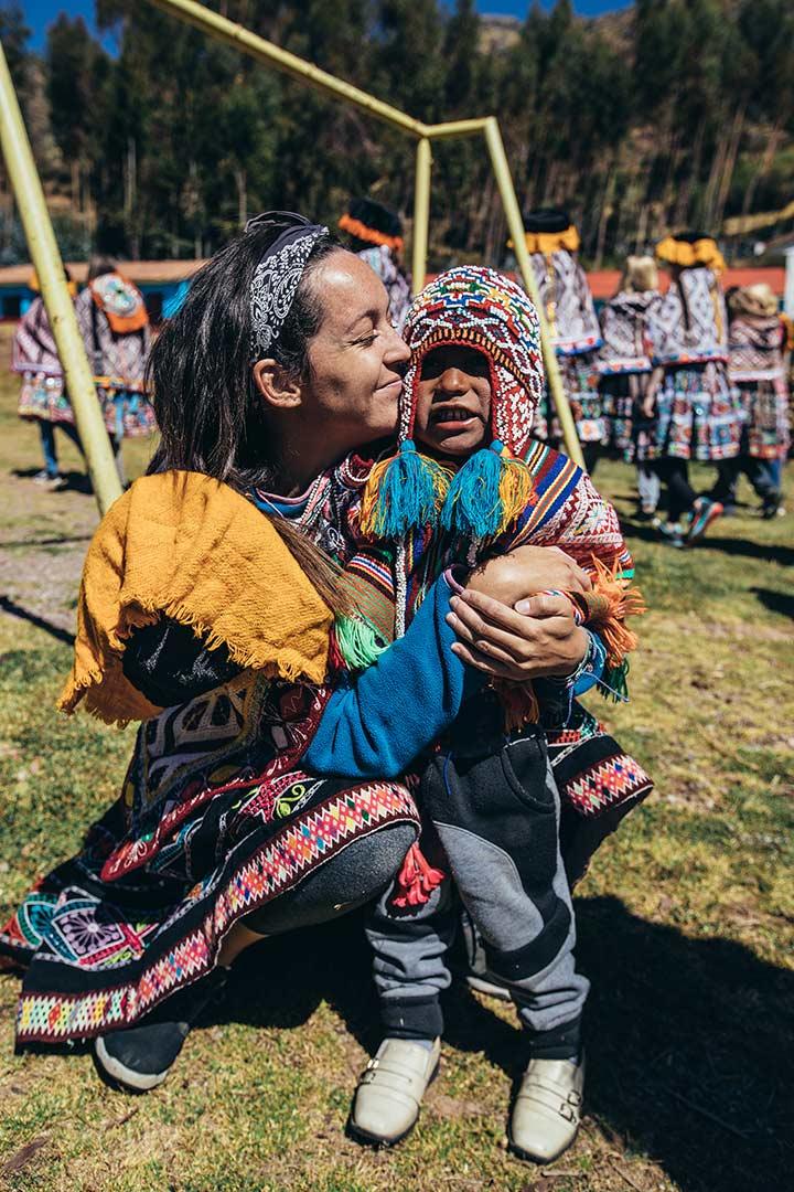 Woman holding a Peruvian boy.