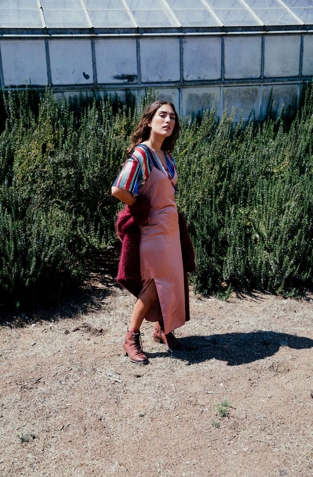 Woman in dress wearing the Teva Foxy Lace WP boots.
