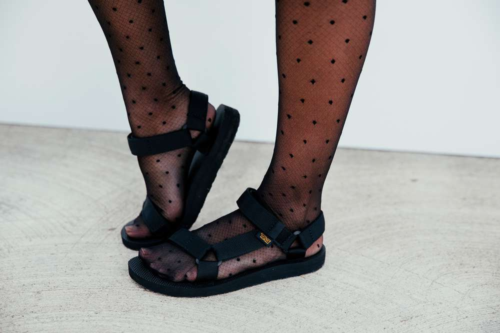 Feet in stockings and Teva Original Universal Leather Premiere
