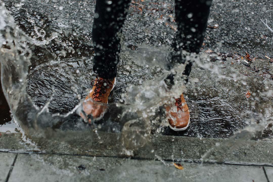 Feet splashing in puddle.