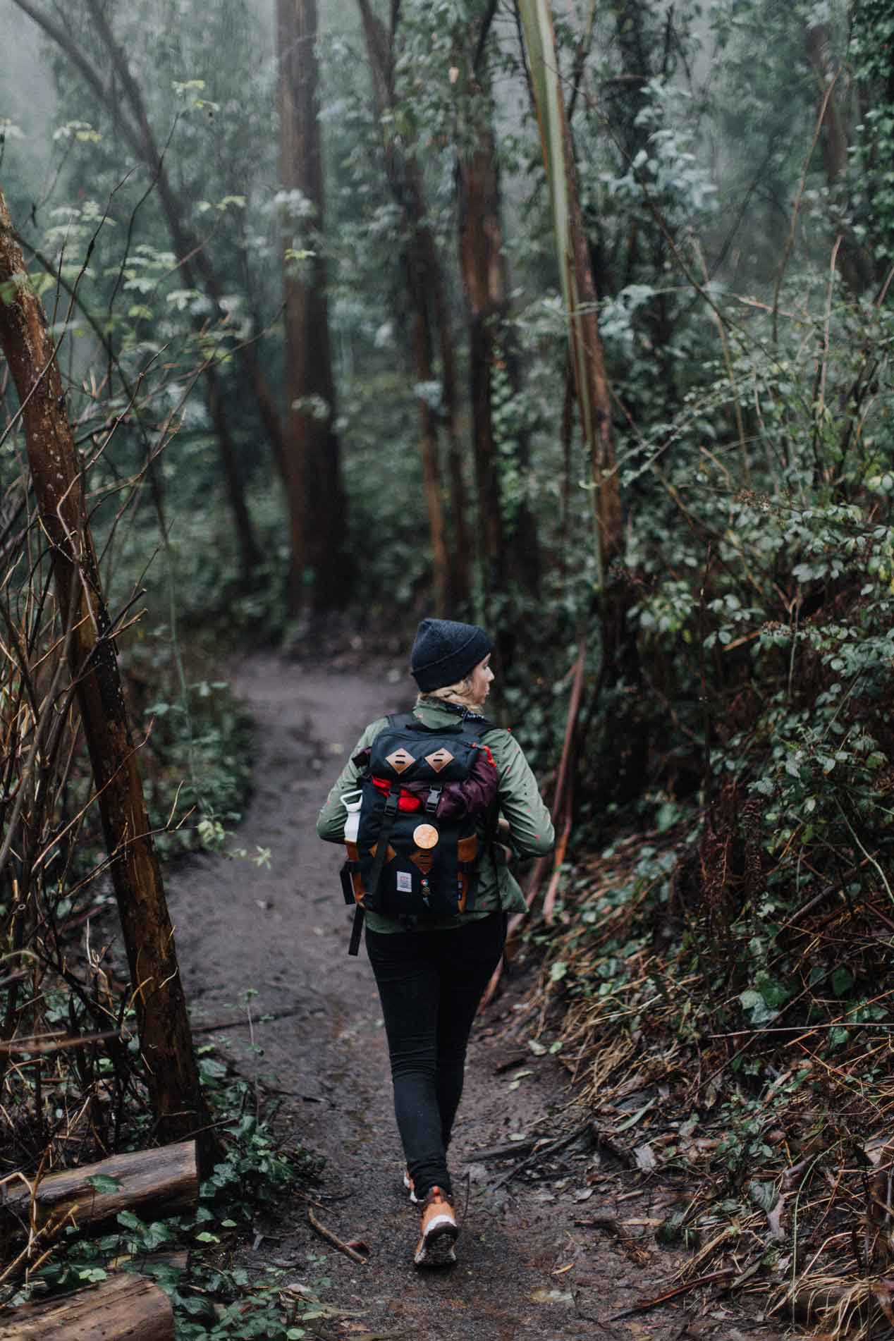Woman hiking in forest near San Francisco.