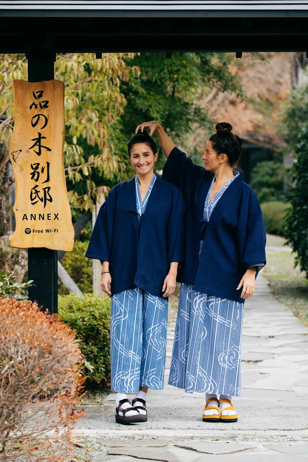 Two women dressed in matching outfits in Japan.