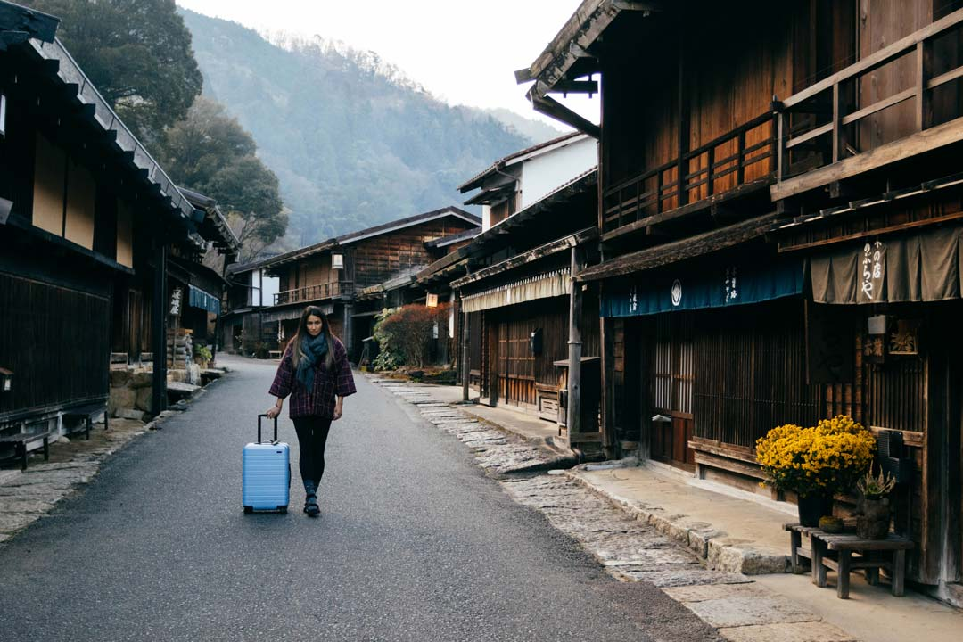 Woman with suitcase walking in Japan