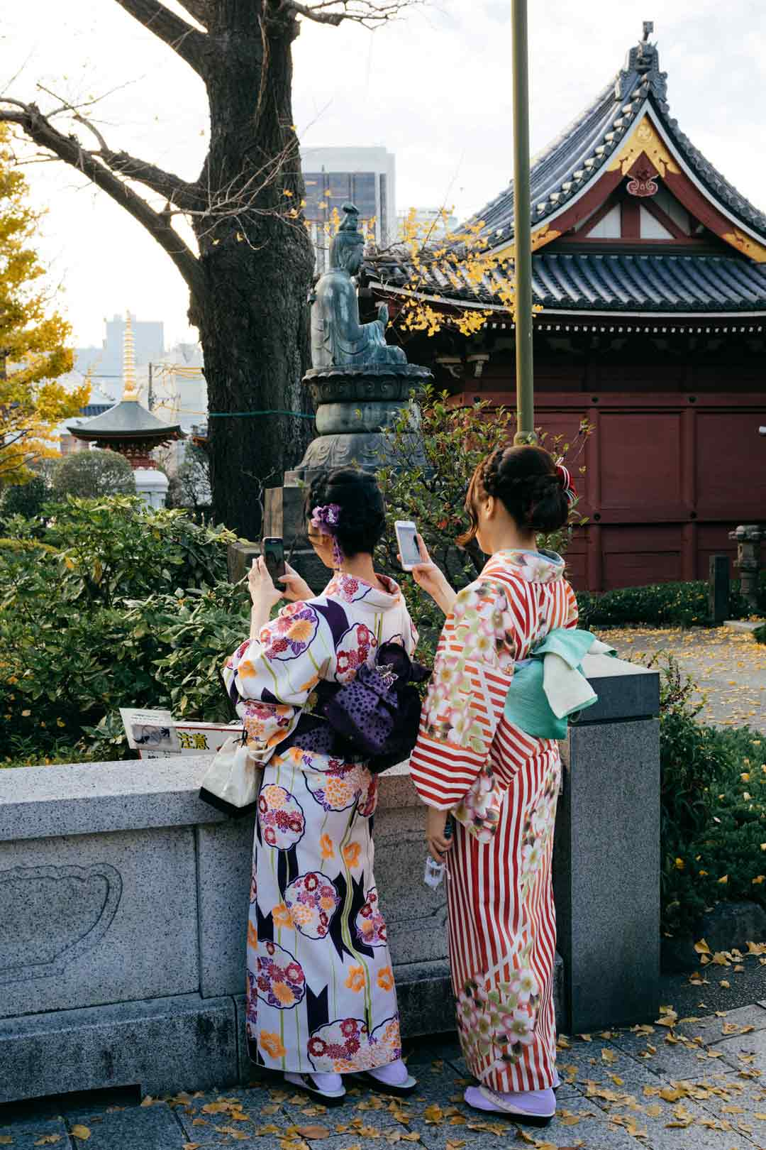 Two women dressed as traditional Geishas in Japan.