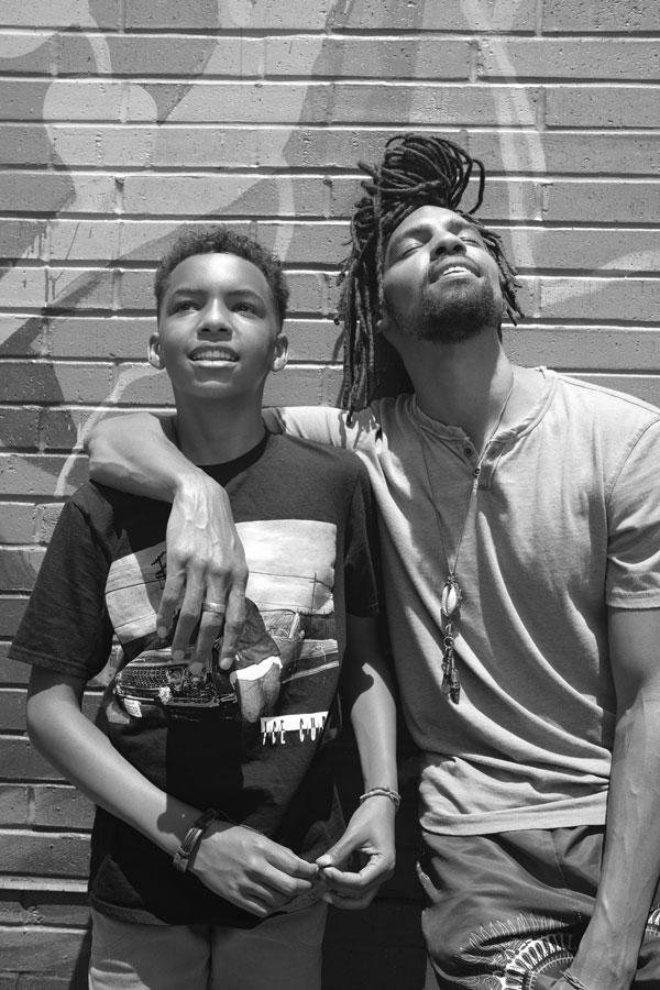 Father, husband, and community leader Pierce Freelon and his son.
