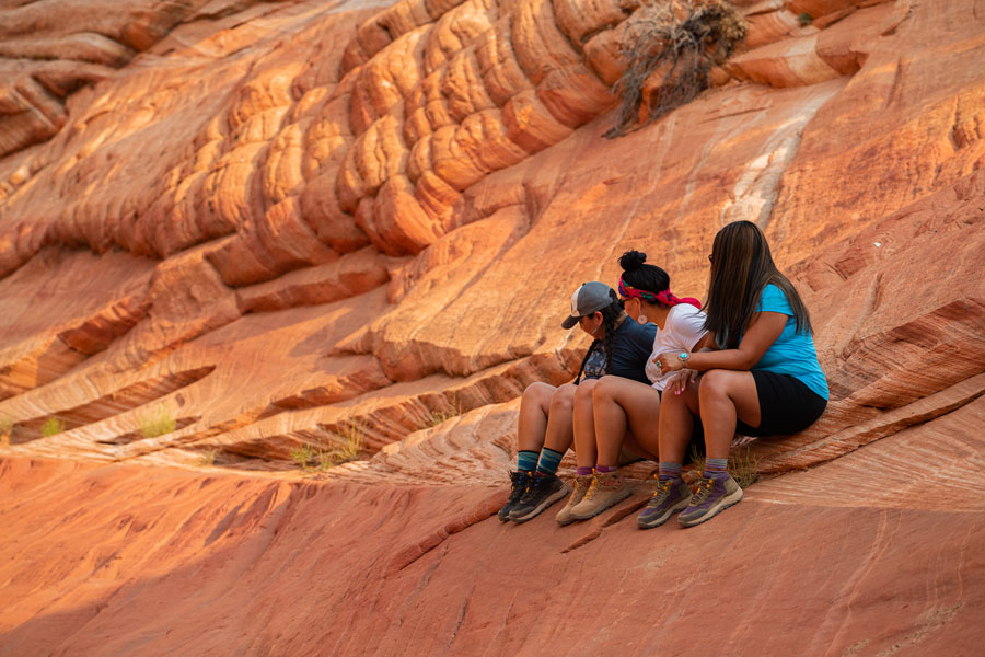 Angel Tadytin and sisters explore canyons.