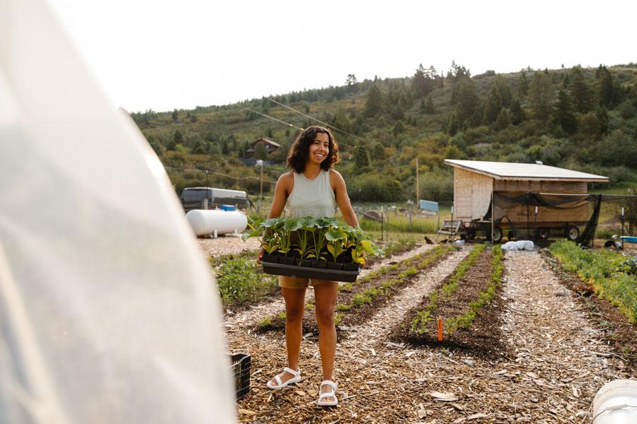 Vanessa tending to gardens.